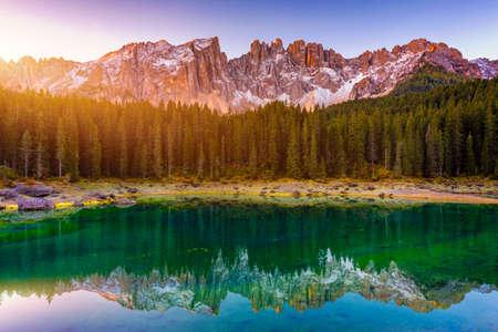 Carezza lake (Lago di Carezza, Karersee) with Mount Latemar, Bolzano province, South tyrol, Italy. Landscape of Lake Carezza or Karersee and Dolomites in background, Nova Levante, Bolzano, Italy. Reklamní fotografie