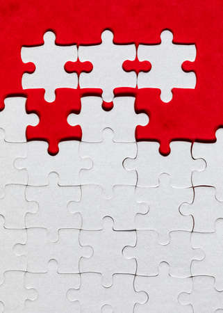 Closeup of jigsaw puzzle isolated. Missing jigsaw puzzle piece, business concept for completing the puzzle piece. Group of puzzle and a puzzle piece. Teamwork concept. Think difference concept. Banque d'images - 137153092