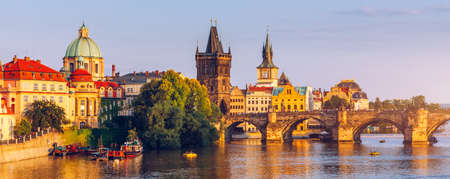 Scenic view of the Old Town pier architecture and Charles Bridge over Vltava river in Prague, Czech Republic. Prague iconic Charles Bridge (Karluv Most) and Old Town Bridge Tower at sunset, Czechia. Banco de Imagens - 137153145