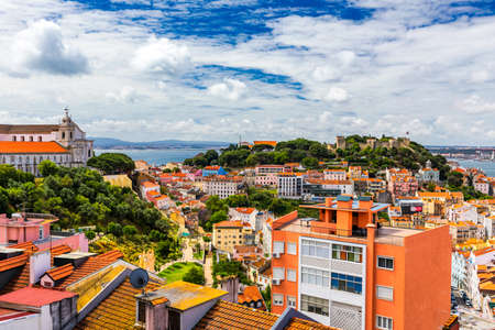 Lisbon, Portugal skyline with Sao Jorge Castle. Panoramic aerial view of Lisbon, Portugal. Panorama view of old town Lisbon and Sao Jorge Castle, the capital and the largest city of Portugal. Standard-Bild - 137153164