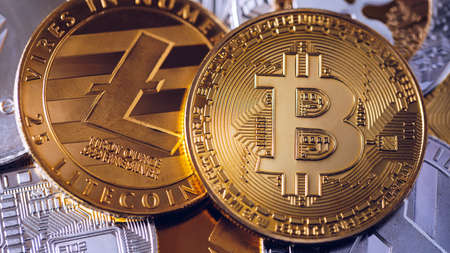 Stack of cryptocurrencies with a golden bitcoin. Bitcoin as most important cryptocurrency concept. Bitcoin. Physical bit coin. Digital currency. Cryptocurrency. Golden coin with bitcoin Standard-Bild - 137153165