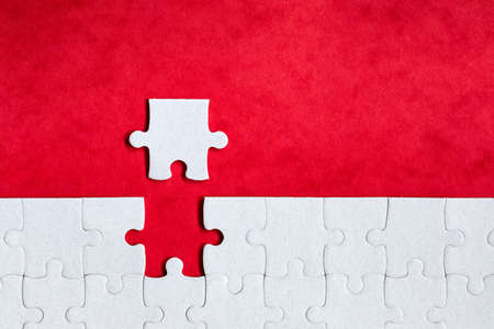 Closeup of jigsaw puzzle isolated. Missing jigsaw puzzle piece, business concept for completing the puzzle piece. Group of puzzle and a puzzle piece. Teamwork concept. Think difference concept.  Stock Photo