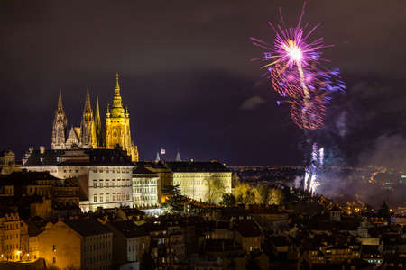 Fireworks over the Old Town of Prague, Czech Republic. New Year fireworks in Prague, Czechia. Prague fireworks during New Year Celebration near St. Vitus Cathedral, Prague, Czech republic.