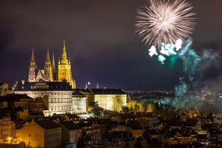 Fireworks over the Old Town of Prague, Czech Republic. New Year fireworks in Prague, Czechia. Prague fireworks during New Year Celebration near St. Vitus Cathedral, Prague, Czech republic. Standard-Bild - 137153184