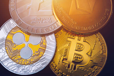Set of cryptocurrencies with Bitcoin, Etherium, Ripple, Litecoin. Cryptocurrencys new digital money. Bitcoin on the front as the leader. Bitcoin as most important cryptocurrency. Standard-Bild - 137153199