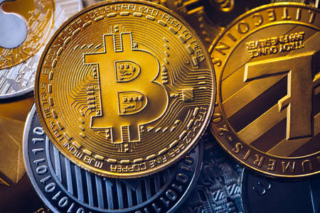 Set of cryptocurrencies with Bitcoin, Etherium, Ripple, Litecoin. Cryptocurrencys new digital money. Bitcoin on the front as the leader. Bitcoin as most important cryptocurrency. Banco de Imagens - 137153204