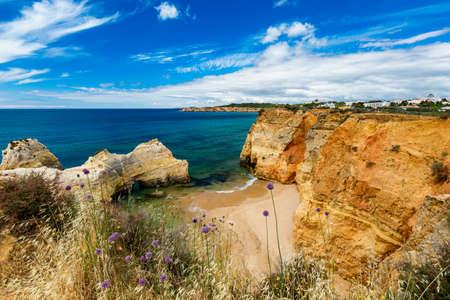 Careanos Beach (Praia dos Careanos) in Portimao, Algarve, Portugal. Concept for travel in Portugal and summer vacations in Portimao, Algarve, Portugal. Banco de Imagens - 137153689