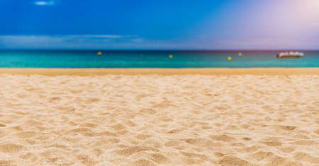 Soft wave of blue ocean on sandy tropical beach. Background of tropical paradise beach with golden sand, travel tourism panorama background concept. Sand and sea waves background. Banque d'images - 137153507