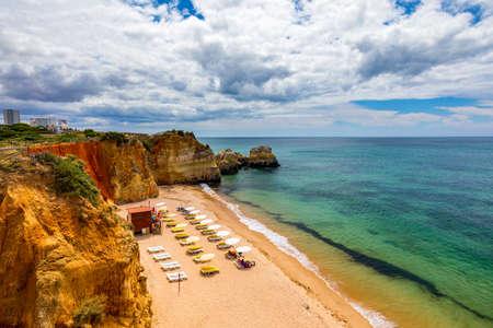 Careanos Beach (Praia dos Careanos) in Portimao, Algarve, Portugal. Concept for travel in Portugal and summer vacations in Portimao, Algarve, Portugal.