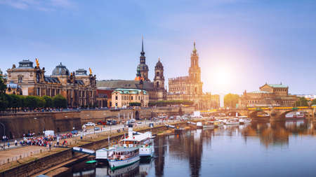 Incredible evening panorama of Cathedral of the Holy Trinity or Hofkirche, Bruehl's Terrace or The Balcony of Europe. Dramatic autumn sunset on Elbe river in Dresden, Saxony, Germany, Europe.