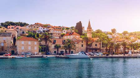 Fishing boats in Splitska village with beautiful port, Brac island, Croatia. Village of Splitska on Brac island seafront view, Dalmatia, Croatia, Croatia.
