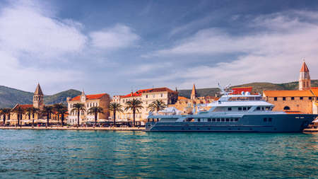 Historic buildings on promenade in Trogir, Croatia. Trogir is popular travel destination in Croatia. Trogir, as a UNESCO World Heritage Site, is one of most visited places in Dalmatia, Croatia.