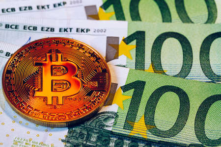 Golden bitcoin over Euro money. Bitcoin cryptocurrency. Crypto currency concept. Bitcoin with euro bills. Bitcoins stacked on euro banknotes. Banque d'images - 138377330