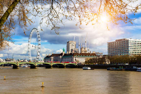 Cityscape of London including London Eye and Westminster Bridge on Thames River Banco de Imagens
