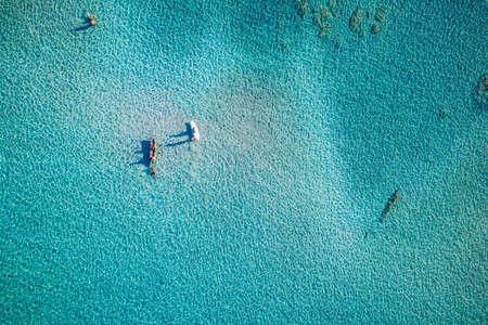 Aerial view of beautiful tropical Elafonissi Beach with pink sand. View of a nice tropical Elafonissi beach from the air. Beautiful sky, sea, resort. Elafonissi beach, Crete, Greece.