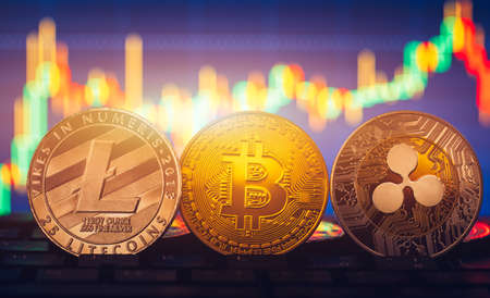 Bitcoin, litecoin and ripple coins currency finance money on graph chart background. Bitcoin as most important cryptocurrency concept. Stack of cryptocurrencies with a golden bitcoin in the middle. Imagens