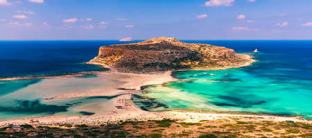 Fantastic panorama of Balos Lagoon and Gramvousa island on Crete, Greece. Cap tigani in the center. Balos beach on Crete island, Greece. Tourists relax and bath in crystal clear water of Balos beach. Imagens