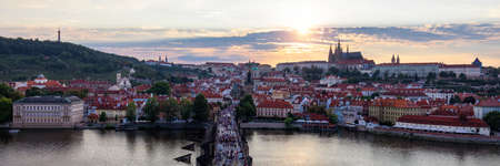 Scenic summer aerial panorama of the Old Town architecture in Prague, Czech Republic. Red roof tiles panorama of Prague old town.  Prague Old Town Square houses with traditional red roofs. Czechia. Imagens