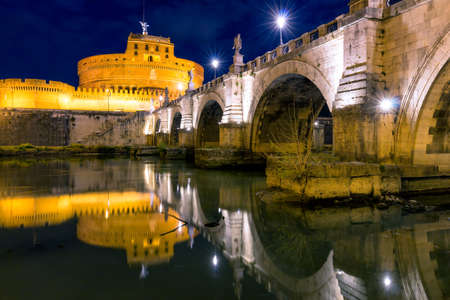 The Mausoleum of Hadrian, usually known as the Castle of the Holy Angel (Castel Sant Angelo) and Ponte SantAngelo bridge, a towering cylindrical building in Parco Adriano, Rome, Italy