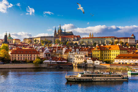 Prague Castle, Charles Bridge and boats on the Vltava river. View of Hradcany Prague Castle, Charles Bridge and a boats on the Vltava river in the capital of the Czechia. Boat cruise on Vltava river. Archivio Fotografico - 138404751