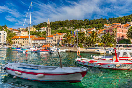 View at amazing archipelago with boats in front of town Hvar, Croatia. Harbor of old Adriatic island town Hvar. Popular touristic destination of Croatia. Amazing Hvar city on Hvar island, Croatia. Archivio Fotografico - 139275564