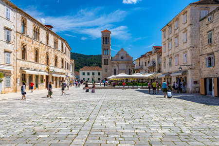 Main square in old medieval town Hvar. Hvar is one of most popular tourist destinations in Croatia in summer. Central Pjaca square of Hvar town, Dalmatia, Croatia.