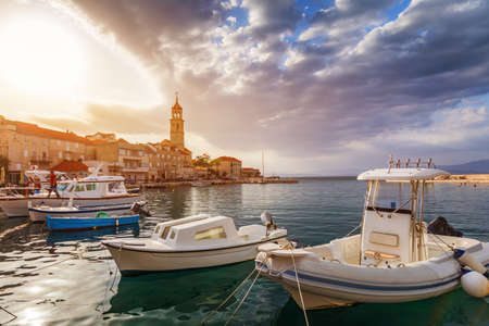 Fishing boat anchoring in beautiful Sutivan port, Brac island, Croatia. Sutivan on Island Brac in Croatia. Made of well known white limestone. Port with fishing boats. Sutivan, Brac, Croatia. 스톡 콘텐츠