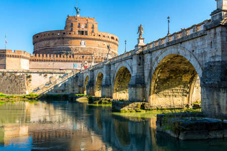 Rome, Italy. Ponte Sant Angelo, Castel Sant Angelo and Tiber River. Built by Hadrian emperor as mausoleum in 123AD ancient Roman Empire landmark. Archivio Fotografico - 139240827