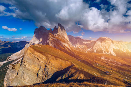 Seceda in autumn in South Tyrol in the Alps of North Italy. Views from Seceda over the Odle mountains in autumn with fall colors. Seceda, Val Gardena, Trentino Alto Adige, South Tyrol in Italy. Stock fotó