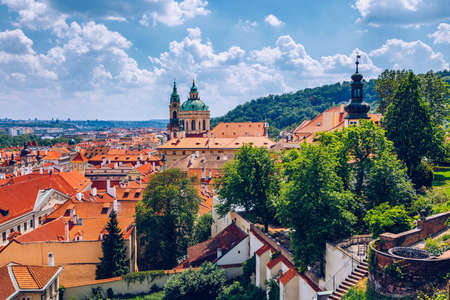 Top view to red roofs skyline of Prague city, Czech Republic. Aerial view of Prague city with terracotta roof tiles, Prague, Czechia. Old Town architecture with terracotta roofs in Prague.