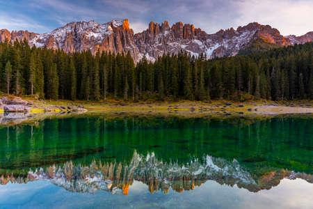 Carezza lake (Lago di Carezza, Karersee) with Mount Latemar,South tyrol, Italy. Landscape of Lake Carezza or Karersee and Dolomites in background, Nova Levante, Bolzano, Italy.