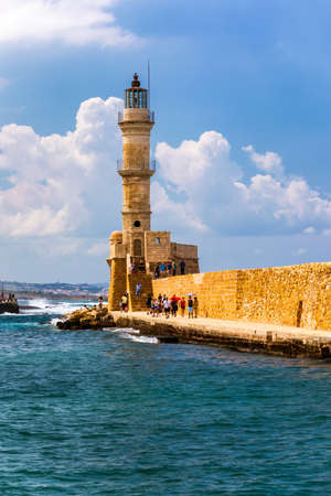 Panorama of venetian harbour waterfront and lighthouse in old harbour of Chania, Crete, Greece. Old venetian lighthouse in Chania, Greece. Lighthouse of the old Venetian port in Chania, Greece. Фото со стока - 142068508