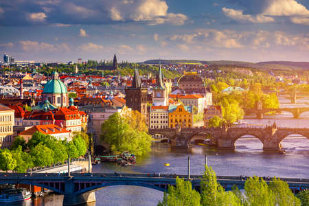 Scenic view of the Old Town pier architecture and Charles Bridge over Vltava river in Prague, Czech Republic. Prague iconic Charles Bridge (Karluv Most) and Old Town Bridge Tower at sunset, Czechia. Фото со стока - 142068653