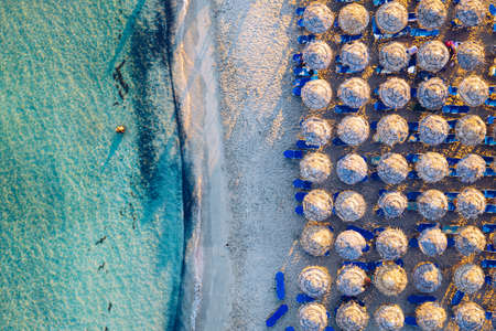 Aerial view of beautiful tropical Elafonissi Beach with pink sand. View of a nice tropical Elafonissi beach from the air. Beautiful sky, sea, resort. Elafonissi beach, Crete, Greece. Фото со стока - 142068652