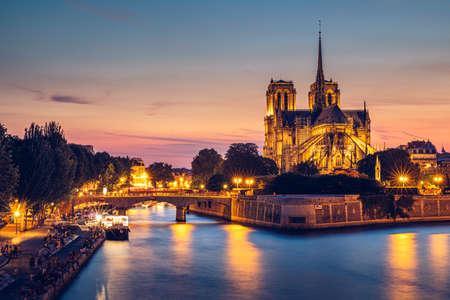 Notre Dame de Paris cathedral at sunset, France. Notre Dame de Paris, most beautiful Cathedral in Paris. Picturesque sunset over Cathedral of Notre Dame de Paris, destroyed in a fire in 2019, Paris. Фото со стока - 142093750