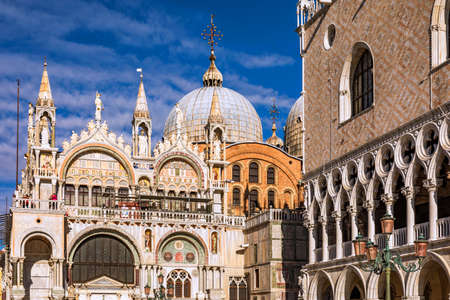 San Marco square with Campanile and Saint Mark's Basilica. The main square of the old town. Venice, Italy. Standard-Bild - 142093769