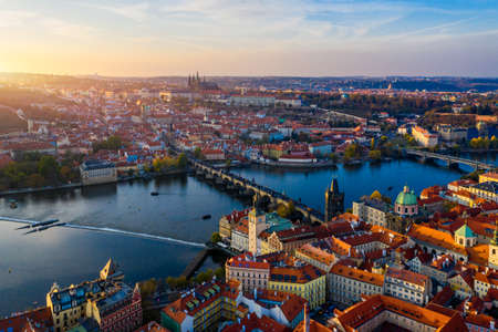 Aerial Prague panoramic drone view of the city of Prague at the Old Town Square, Czechia. Prague Old Town pier architecture and Charles Bridge over Vltava river in Prague at sunset, Czech Republic. Standard-Bild - 142093870