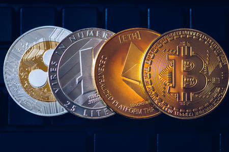 Set of cryptocurrencies with Bitcoin, Etherium, Ripple, Litecoin. Cryptocurrencys new digital money. Bitcoin on the front as the leader. Bitcoin as most important cryptocurrency.
