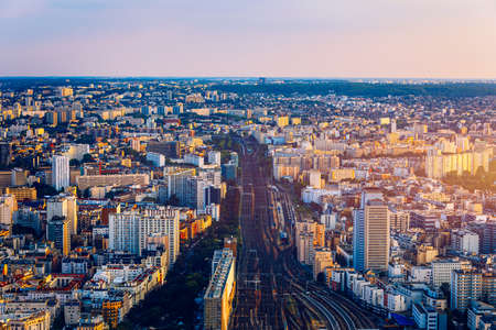 Top view of Paris skyline from above. Main landmarks of european megapolis with train station of Vaugirard-Belt. Bird-eye view from observation deck of Montparnasse tower. Paris, France