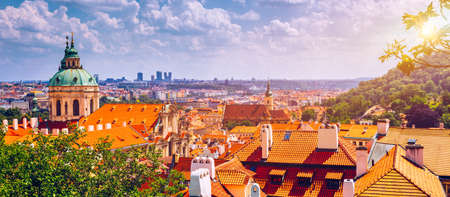 Top view to red roofs skyline of Prague city, Czech Republic. Aerial view of Prague city with terracotta roof tiles, Prague, Czechia. Old Town architecture with terracotta roofs in Prague. Stockfoto