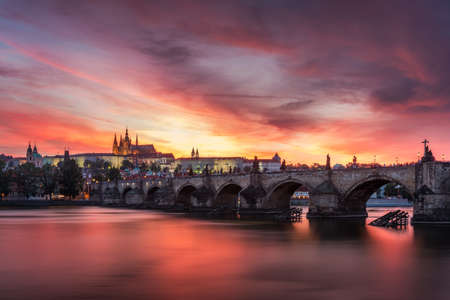 Charles Bridge at sunset with colorful sky, Prague, Czech Republic. Prague old town and iconic Charles bridge and Castle, Czech Republic. Charles Bridge (Karluv Most), Old Town Tower and Castle.