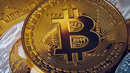 Stack of cryptocurrencies with a golden bitcoin. Bitcoin as most important cryptocurrency concept. Bitcoin. Physical bit coin. Digital currency. Cryptocurrency. Golden coin with bitcoin