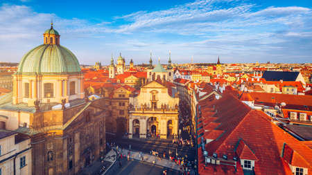 Scenic summer aerial panorama of the Old Town architecture in Prague, Czech Republic. Red roof tiles panorama of Prague old town.  Prague Old Town Square houses with traditional red roofs. Czechia. Stock fotó