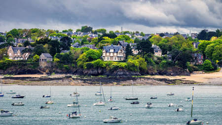 View of Dinard city with coastline full of boats. Brittany, France