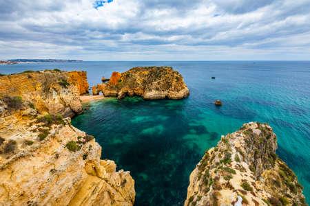 Joao de Arens beach (Praia João de Arens), Algarve, Portimao, Portugal. Remote beach, hidden beach, Praia da Ponta Joao de Arens, Portimao, Algarve, Portimao.