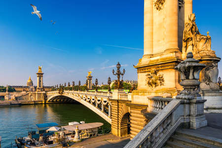 Pont Alexandre III bridge over river Seine in the sunny summer morning. Bridge decorated with ornate Art Nouveau lamps and sculptures. The Alexander III Bridge across Seine river in Paris, France. Stock fotó