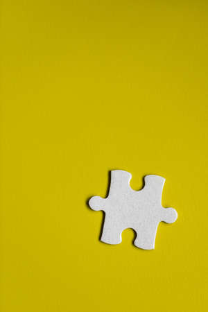 Closeup of jigsaw puzzle isolated. Missing jigsaw puzzle piece, business concept for completing the puzzle piece. Group of puzzle and a puzzle piece. Teamwork concept. Think difference concept.