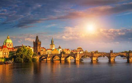Prague, Czech Republic panorama with historic Charles Bridge and Vltava river on sunny day.