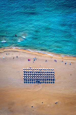 People swimming in the sea. Aerial view, Top view. The color of the water and beautifully bright. Swimming and relaxing in the sea blue aerial top view. Top view from flying drone.