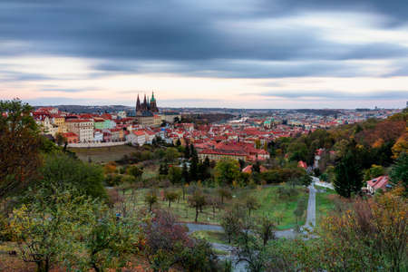 Prague autumn landscape. Prague autumn landscape view to Saint Vitus cathedral. Prague. Prague panorama. Prague, Czech Republic. Scenic autumn aerial view of the Old Town with red foliage. Czechia. Stock fotó